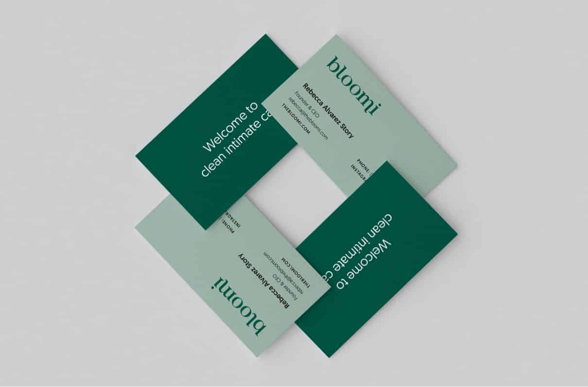 Front and back of the Bloomi business card designs