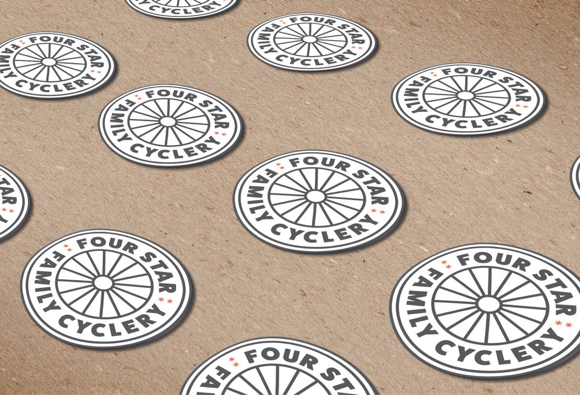 Chicago-based Four Star Family Cyclery sticker designs lined up on a cardstock background