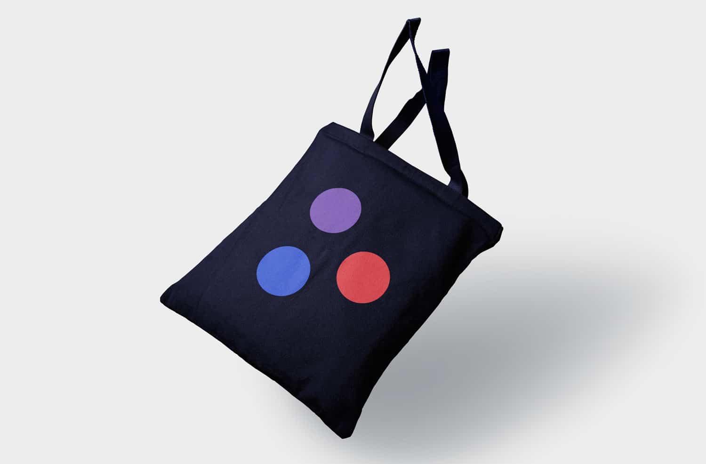 Proper Media's logomark printed on a tote bag